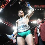 Conor McGregor is declared the winner by knockout and crowned champion during UFC 194 at MGM Grand Garden Arena.