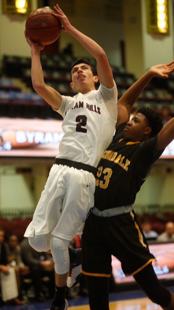 Byrum Hills Skylar Sinon (2) shoots during the game against Uniondale's Zion Styles (23) in the consolation game at the18th Annual Slam Dunk Tournament at the Westchester County Center in White Plains on Dec. 29, 2016.  Byrum Hills won 61- 47.