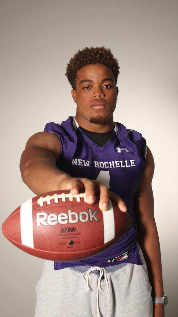 Jonathan Saddler, a quarterback and linebacker with New Rochelle High School, photographed Aug. 18, 2017.
