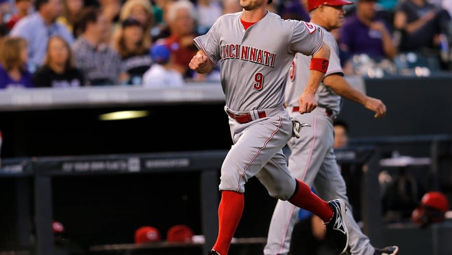 Cincinnati Reds' Jack Hannahan scores during the fourth inning.