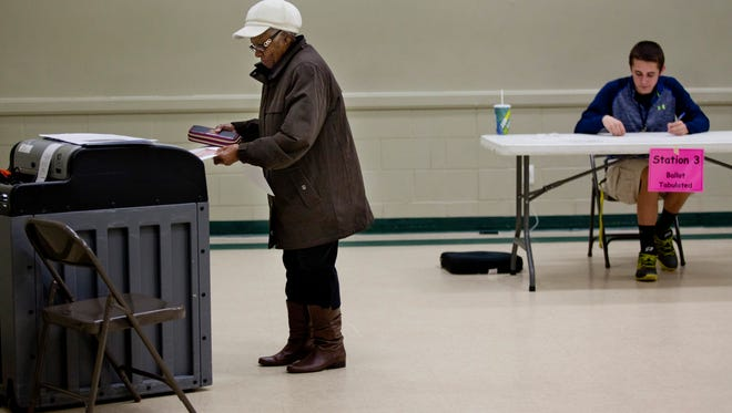 Port Huron resident Ila Shoulders casts her ballot Tuesday, May 5, 2015 in Precinct 10 at the Eleger Harvey Reinvestment Center in Port Huron.