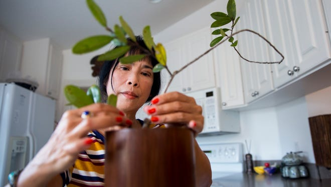 Minh Haeusler arranges an ikebana in her home on Friday, Feb. 3, 2017 in Naples, Florida. Ikebana is the Japanese art of living flower arrangement where nature and humanity are brought together.