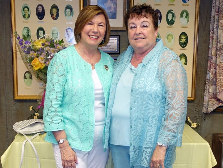 Mary Wolfe (left), a member of the Woman's Club of