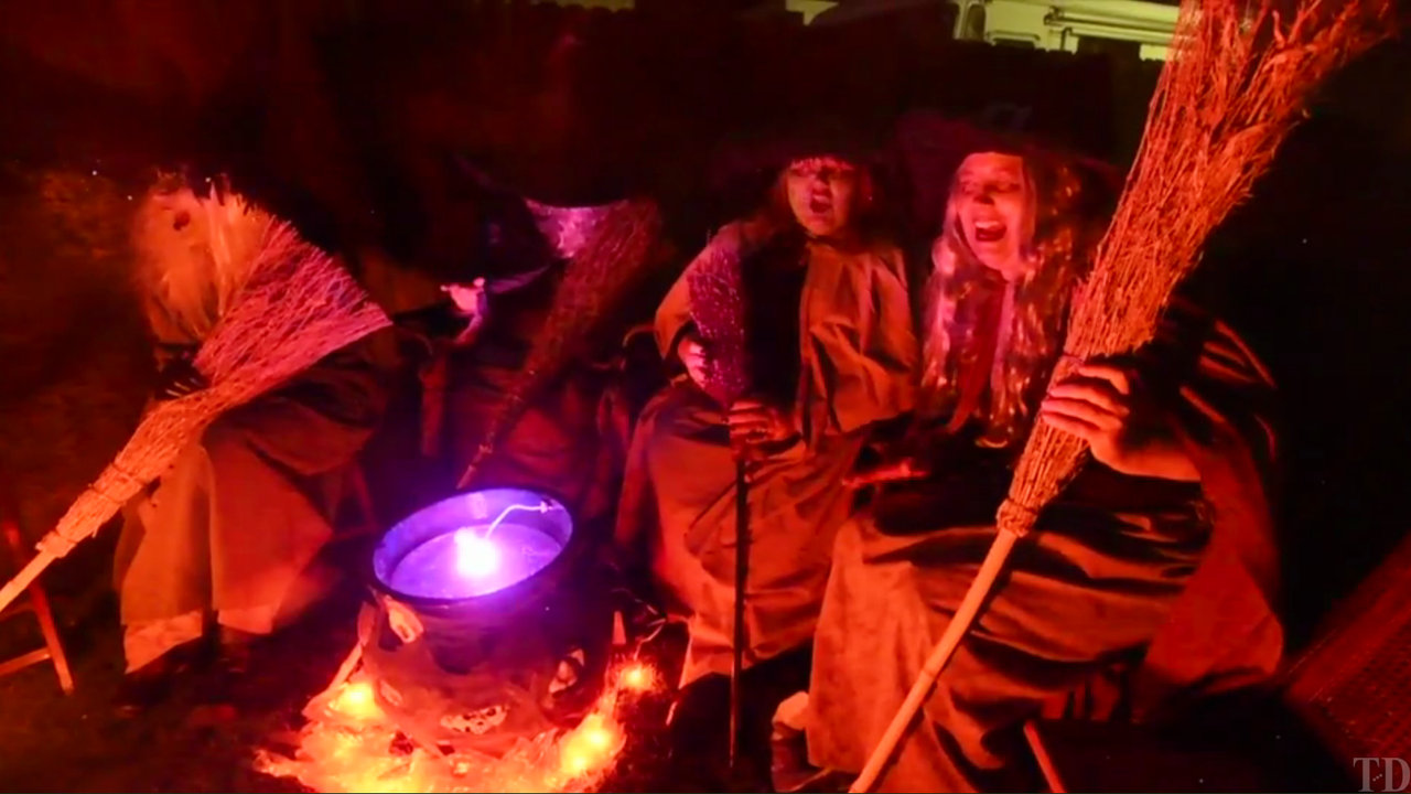 """Glenda Hoppert, Lea Demmers, Lisa Dillon, Carol Hays and her sister Deanna O'Leary or """"The Witches of Hayswick,"""" as they are known on Halloween, gather around a cauldron at West Sunnyside Avenue and South Vintage Street in Visalia."""
