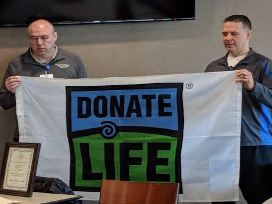 On April 2, Aurora Medical Center in Manitowoc County participated in a statewide Donate Life flag-raising ceremony and moment of silence to promote the mission of organ, tissue and eye donation, and honor donors and their families.