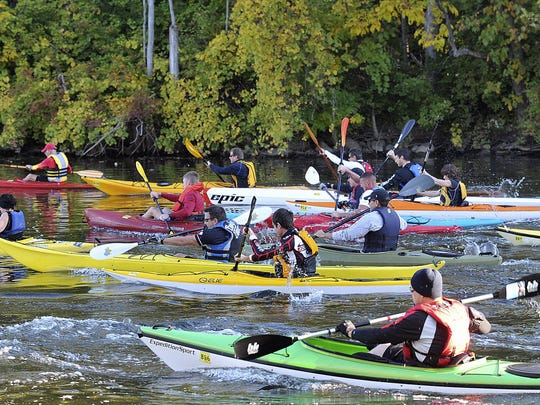 Kayakers take to the water portion of the Grand Ledge Grand Adventure triathalon on Sept. 28, 2012. The event includes kayaking, biking and running in Grand Ledge.