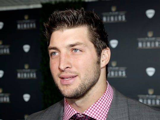 Denver Broncos Tim Tebow arrives for the inaugural NFL Honors show Saturday, Feb. 4, 2012, in Indianapolis.