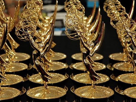 FILE - In this Sept. 23, 2012 file photo, statues of the 64th Emmy awards are displayed on a table backstage at the 64th Primetime Emmy Awards at the Nokia Theatre in Los Angeles. The 67th annual Primetime Emmy Awards airs Sunday, Sept. 20, 2015, at 8 ET/5 PT on FOX.