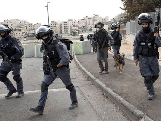 Israeli riot police officers operate in the Arab neighborhood of Issawiyeh in Jerusalem, Tuesday, Oct. 20, 2015. U.N. Secretary-General Ban Ki-moon will make a surprise visit to Israel and the Palestinian territories on Tuesday, in a high-profile gambit to bring an end to the monthlong wave of violence that has plagued the region.