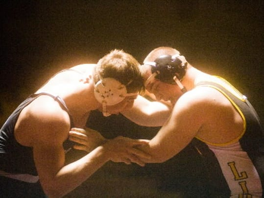Red Lion's Anthony Moser shown here grappling South Western's Skylar Bowman, will lead the Lions against the Mustangs and Rockets this week in a pair of crucial Division I contests. Clare Becker - The Evening Sun
