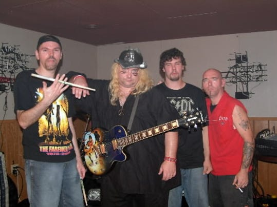 Heavy Burden, a local classic rock cover band, tries to bring audiences back to the  80s at their shows