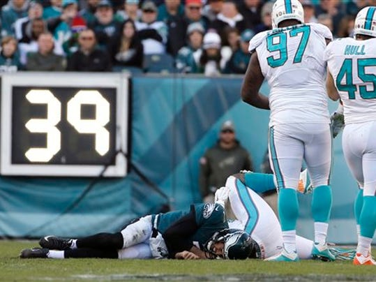 Philadelphia Eagles quarterback Sam Bradford lies on the field after a hit during the second half against the Miami Dolphins on Sunday in Philadelphia. Bradford left the game and did not return.  Summary