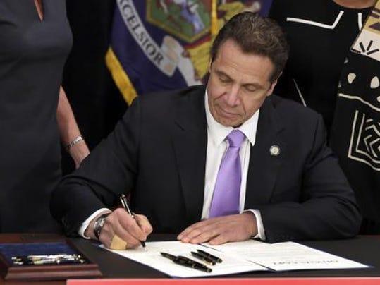 Cuomo bill signing minimum wage