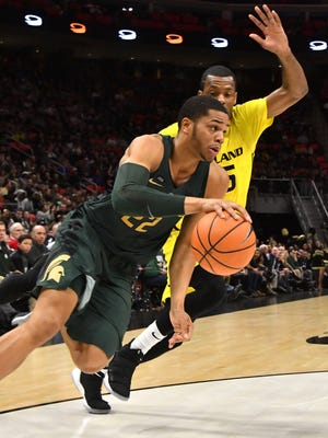 Michigan State's Miles Bridges drives past Oakland's Martez Walker during the Spartans' win Saturday at Little Caesars Arena.