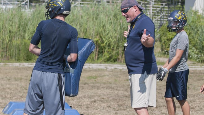 Algonac' coach Scott Barnhart talks to his players Wednesday, Aug. 10 , 2016 during their football practice at Algonac High School.