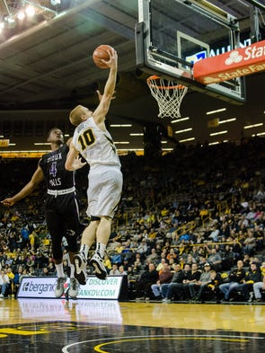 Mike Gesell makes a layup during the Hawkeyes exhibition