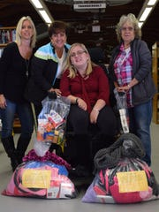 Dorothy Jester, Lisa Jester, Jessica Jester and Joan Legg are pictured with two completed Blessings Bags.