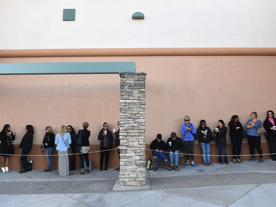 Shoppers line up to take advantage of the opening of a new Nordstrom Rack store in Reno on March 26, 2015.