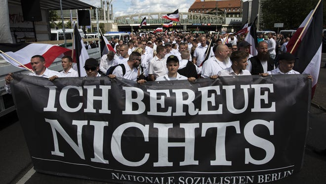 About 1,000 people affiliated with Neo-Nazi and extreme right groups march through Berlin's Spandau district in commemoration of 30 years to Rudolf Hess's death, on Aug. 19, 2017. Hess, who served as Adolf Hitler's deputy, committed suicide on Aug. 17, 1987 at Spandau Prison.