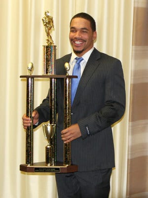 Elmira senior Jerry McPeak with the Ernie Davis Award he won Thursday at the Holiday Inn-Riverview in Elmira.