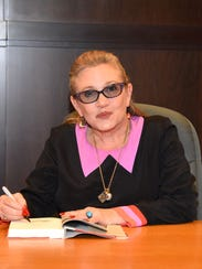 "Carrie Fisher signs copies of her new book ""The Princess"