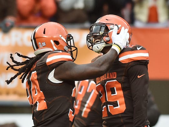 Nov 19, 2017; Cleveland, OH, USA; Cleveland Browns running back Isaiah Crowell (34) and running back Duke Johnson (29) celebrate Johnson's touchdown during the first half against the Jacksonville Jaguars at FirstEnergy Stadium. Mandatory Credit: Ken Blaze-USA TODAY Sports