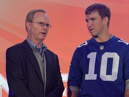 Oct 22, 2016; London, United Kingdom; New York Giants co-owner John Mara (left) and quarterback Eli Manning during NFL Fan Rally at the Victoria House prior to game 16 of the NFL International Series against the Los Angeles Rams. Mandatory Credit: Kirby Lee-USA TODAY Sports
