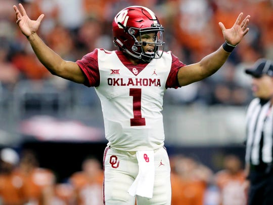 Dec 1, 2018; Arlington, TX, USA; Oklahoma Sooners quarterback Kyler Murray (1) celebrates after throwing a touchdown pass during the first half against the Texas Longhorns in the Big 12 Championship game at AT&T Stadium. Mandatory Credit: Kevin Jairaj-USA TODAY Sports