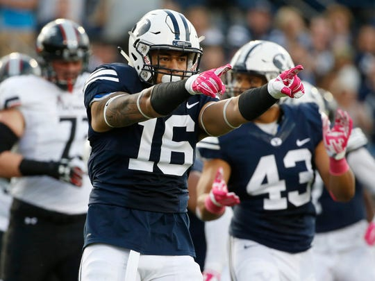 Oct 16, 2015; Provo, UT, USA;  Brigham Young Cougars linebacker Sione Takitaki (16) reacts after making a tackle for no gain against the Cincinnati Bearcats in the first quarter at Lavell Edwards Stadium. Mandatory Credit: Jeff Swinger-USA TODAY Sports
