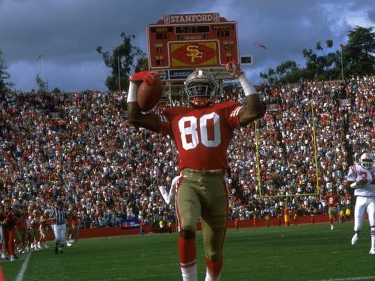 22 OCT 1989:  SAN FRANCISCO 49ERS WIDE RECEIVER JERRY RICE CELEBRATES AFTER SCORING A TOUCHDOWN DURING THE 49ERS 37-20 WIN OVER THE NEW ENGLAND PATRIOTS AT STANFORD STADIUM IN STANFORD, CALIFORNIA.