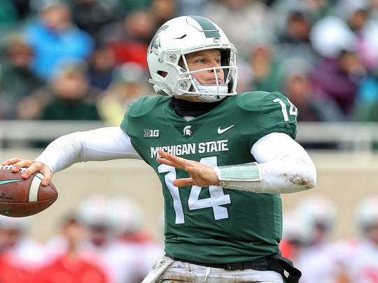 Nov 10, 2018; East Lansing, MI, USA; Michigan State Spartans quarterback Brian Lewerke (14) drops back to pass during the second half of a game against the Ohio State Buckeyes at Spartan Stadium. Mandatory Credit: Mike Carter-USA TODAY Sports