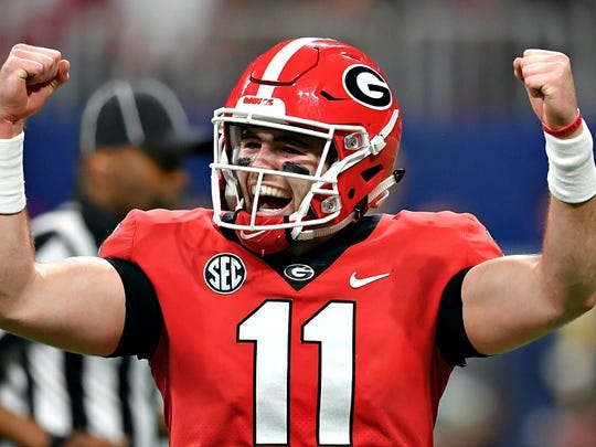 Dec 1, 2018; Atlanta, GA, USA; Georgia Bulldogs quarterback Jake Fromm (11) celebrates after a touchdown against the Alabama Crimson Tide during the second quarter in the SEC championship game at Mercedes-Benz Stadium. Mandatory Credit: Dale Zanine-USA TODAY Sports