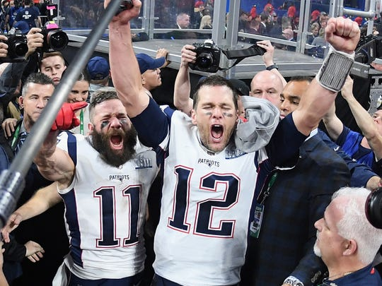 Super Bowl MVP Julian Edelman (left) and New England Patriots quarterback Tom Brady celebrate their victory on Sunday night. Columnist Brad Myers believes future Super Bowls would be even better on a Saturday night.