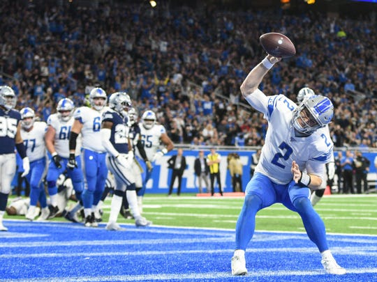 Nov 17, 2019; Detroit, MI, USA; Detroit Lions quarterback Jeff Driskel (2) celebrates his touchdown during the second quarter against the Dallas Cowboys at Ford Field. Mandatory Credit: Tim Fuller-USA TODAY Sports