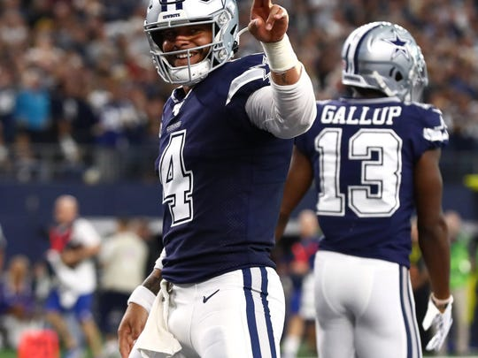 Dec 15, 2019; Arlington, TX, USA; Dallas Cowboys quarterback Dak Prescott (4) celebrates after throwing a second quarter touchdown against the Los Angeles Rams at AT&T Stadium. Mandatory Credit: Matthew Emmons-USA TODAY Sports