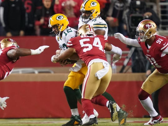 November 24, 2019; Santa Clara, CA, USA; Green Bay Packers quarterback Aaron Rodgers (12) is sacked by San Francisco 49ers middle linebacker Fred Warner (54) creating a fumble during the first quarter at Levi's Stadium. Mandatory Credit: Kyle Terada-USA TODAY Sports