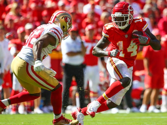 Sep 23, 2018; Kansas City, MO, USA; Kansas City Chiefs wide receiver Sammy Watkins (14) runs against San Francisco 49ers cornerback D.J. Reed (32) in the second half at Arrowhead Stadium. Mandatory Credit: Jay Biggerstaff-USA TODAY Sports