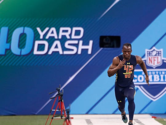 Mar 4, 2017; Indianapolis, IN, USA; Washington Huskies wide receiver John Ross runs the 40 yard dash during the 2017 NFL Combine at Lucas Oil Stadium. Mandatory Credit: Brian Spurlock-USA TODAY Sports