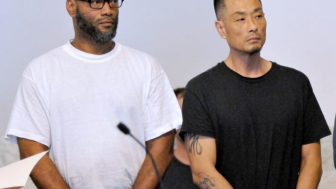 FILE - Charles Lamont Wheeler, left, and Dong Lee are arraigned in Attleboro District Court, Monday, Sept. 17, 2018.