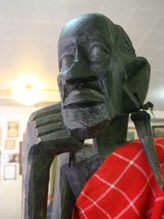 This is Bob The Elder, an African-carved statue who stood watch over the One Fair World store until he was damaged by a vandal in May. A wood carver from Salem's Riverfront Carousel helped restore the carving to its original state and Bob The Elder now stands sentry over the store again.