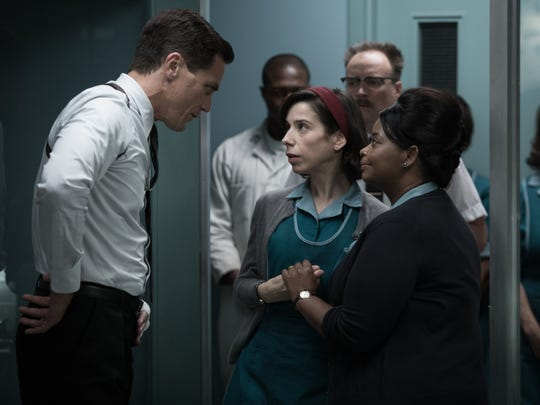 Strickland (Michael Shannon) interrogates Elisa (Sally Hawkins) and Zelda (Octavia Spencer) when an important government asset goes missing in 'The Shape of Water.'