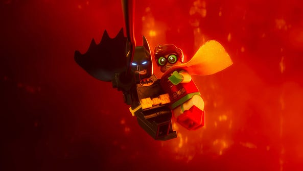 Batman (voiced by Will Arnett) saves Robin from certain