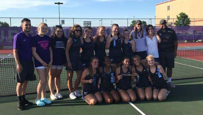 Brownsburg's girls tennis team pose after winning a regional title Wednesday night.