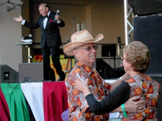 A couple dances as Paul Salos sings songs by Frank Sinatra at the 33rd annual Eldorado Great Italian Festival in 2014.