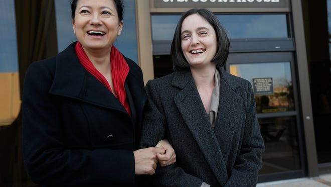 File - In this Feb. 12, 2014 file photo, Cleopatra De Leon, left, and partner, Nicole Dimetman, right, arrive at the U.S. Federal Courthouse, in San Antonio, where a federal judge is expected to hear arguments in a lawsuit challenging Texas' ban on same-sex marriage. On Wednesday, Feb. 26, 2014, Judge Orlando Garcia has struck down the ban but is leaving it in place pending a ruling by an appeals court later this year. (AP Photo/Eric Gay, File)