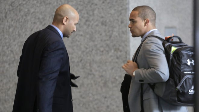 College Athletes Players Association  designated president Ramogi Huma, left, and Northwestern senior quarterback Kain Colter make their way to the beginning of three days of hearings before the National Labor Relations Board on Tuesday in Chicago.