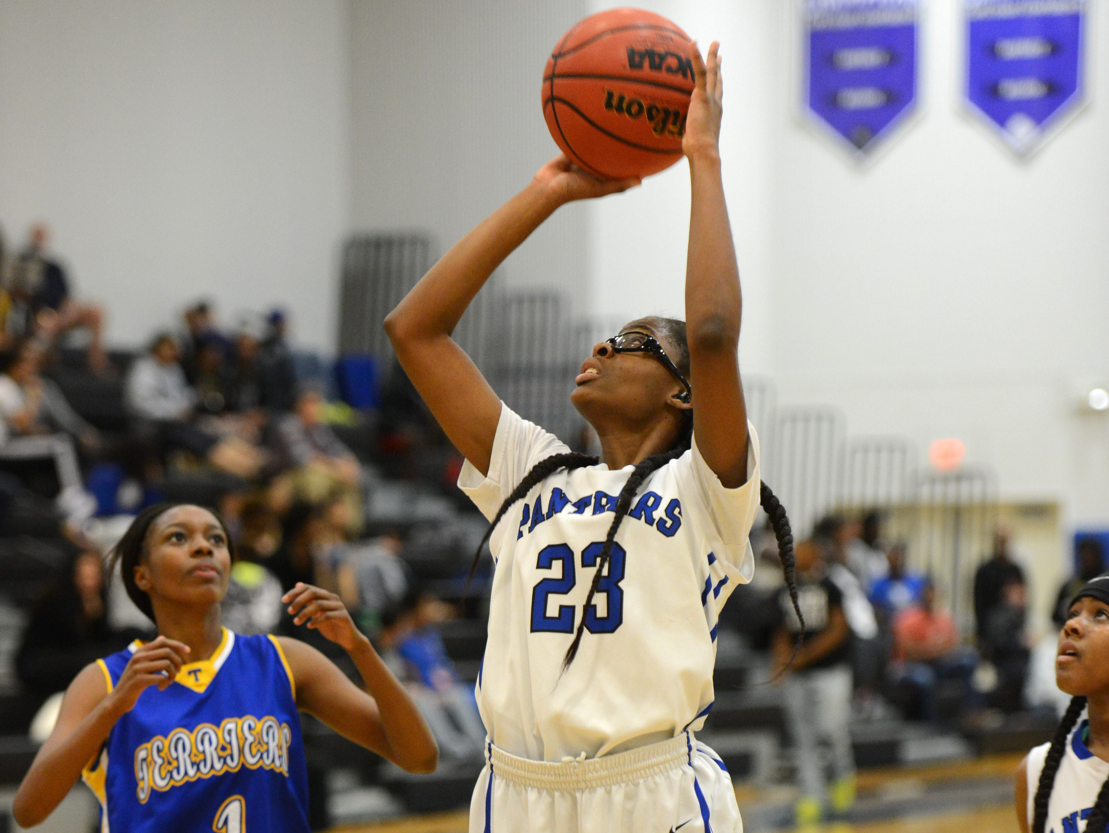 Macoyah Barry of Heritage High takes a shot during a recent game.