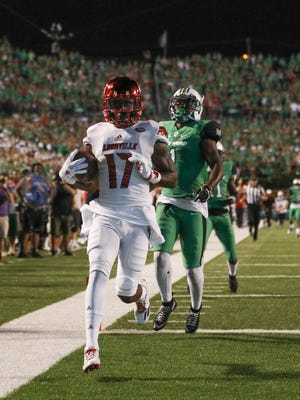 Louisville receiver James Quick cruises in for a TD against Marshall.