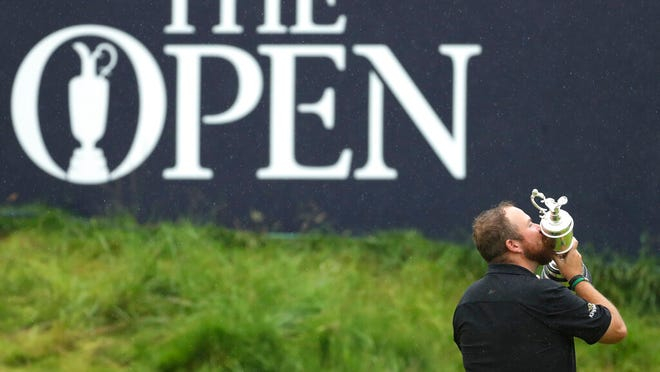 From July 21, 2019, Ireland's Shane Lowry holds and kisses the Claret Jug trophy on the 18th green as he poses for the crowd and media after winning the British Open Golf Championships at Royal Portrush in Northern Ireland. The organizers of the British Open announced Monday April 6, 2020, that they have decided to cancel the event in 2020 due to the current Covid-19 pandemic and that the Championship will next be played at Royal St George's in 2021.