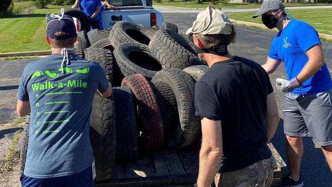 Volunteers at the June 13 Brewer Science special collection unload a trailer full of tires. 477 tires of various sizes were diverted from the landfill at the collection.